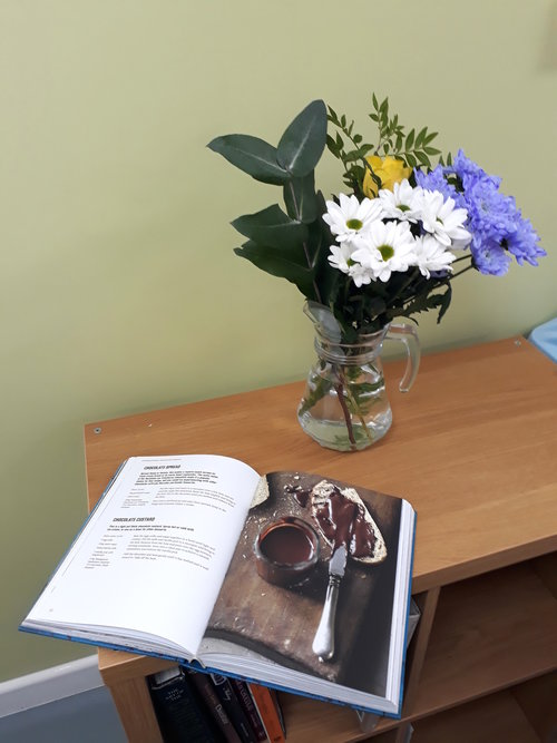 Open book with vase of flowers