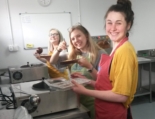 Group having fun making chocolate bars